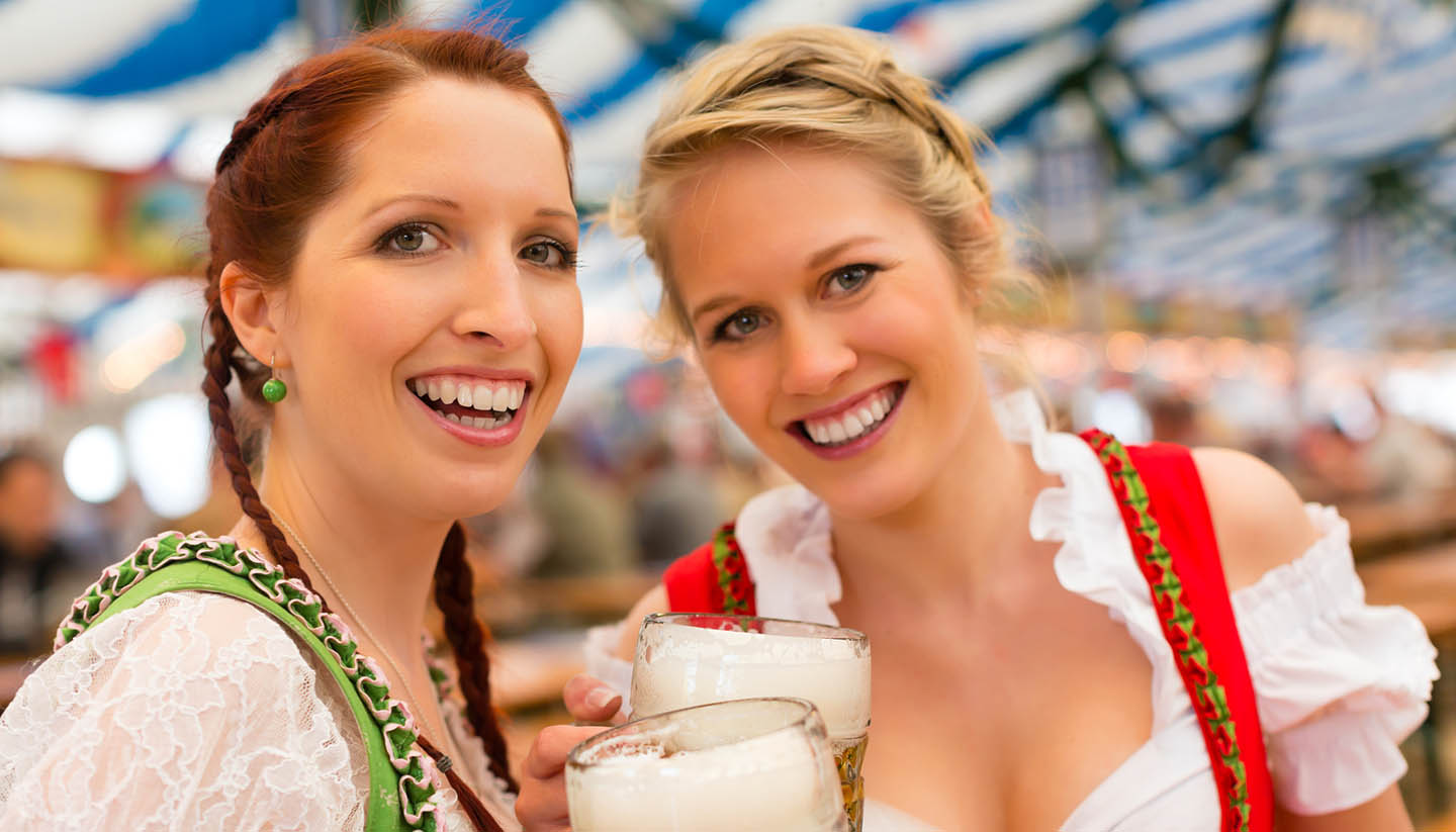 München - Women with traditional Bavarian clothes or dirndl in beer tent