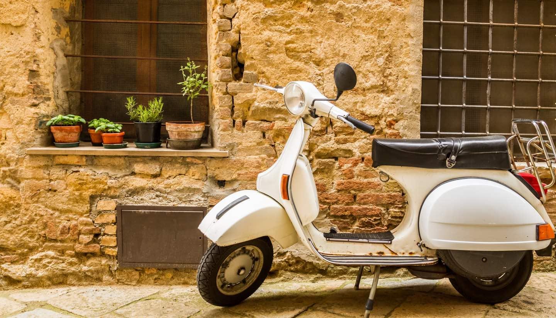 Italien - Vintage scene with Vespa on old street