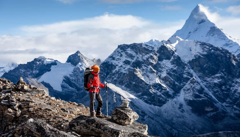 Nepal - Hiker posing at camera on the trek in Himalayas, Nepal