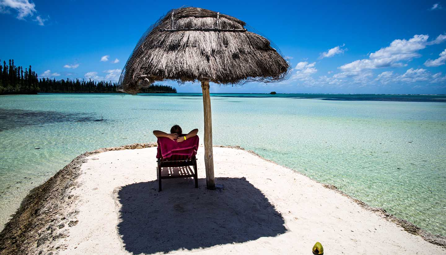 Neukaledonien - Person relaxing on a tropical beach
