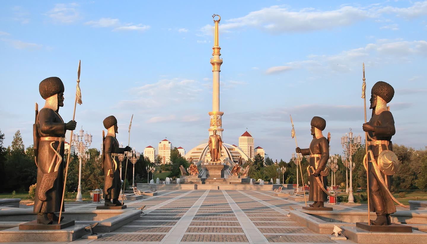 Turkmenistan - Monument Arch of Independence at sunset