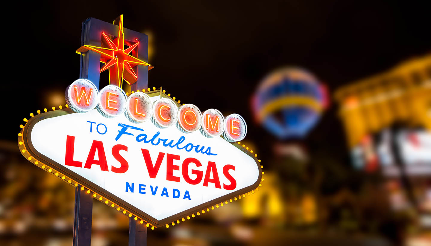 Nevada - Las vegas sign with strip street background