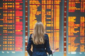Delayed flight - woman looks at departure board